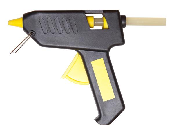Hot glue gun isolated on white